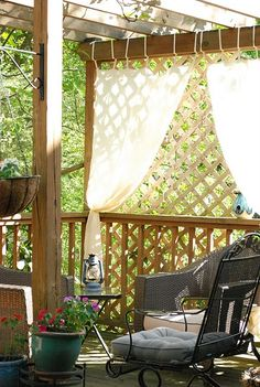 I love the curtain at the end of the pergola- a little extra shade and privacy!@Rebecca Gassaway