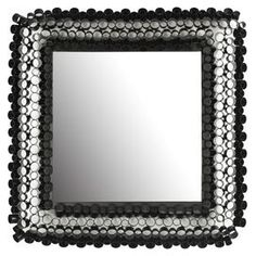 """Wall mirror framed by open iron cylinders.     Product: Wall mirror  Construction Material: Iron and mirrored glass   Color: Glossy black frame   Features:   Openwork design    Various sized cylinders add a three dimensional appeal           Dimensions: 25.2"""" H x 25.2"""" W x 2"""" D"""