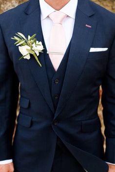 Groomsman in navy blue and blush...could be in light grey too.