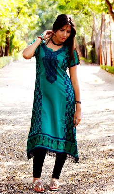 Rama green color Printed tunic with embrodiary in neckline and daman..
