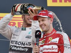 Mercedes driver Lewis Hamilton of Britain celebrates his victory on the podium as he pours champagne over third-placed Ferrari's German driver Sebastian Vettel after the Formula One Japanese Grand Prix in Suzuka.   Kazuhiro Nogi, AFP/Getty Images