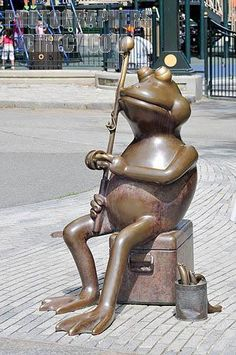 Metal statue or sculpture of a frog fishing at Frog Pond in Boston Common stock photo