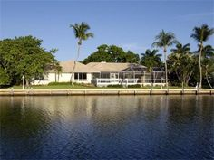 Amazing waterfront property at Ocean Reef features 160 ft. of deep water frontage with wide canal views. This nicely updated home offers 3,282 square feet of air-conditioned living space with four bedrooms, four baths, great room and large open kitchen with all new appliances and cabinets. Located in a wonderful, private setting this home provides an open floor plan great for entertaining.