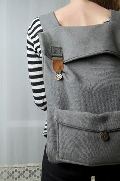 Big laptop backpack in grey with brown buckles by Marinsss on Etsy, $59.00