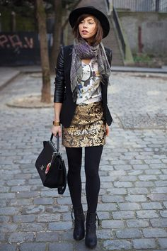 pattern mixing gold brocade patterned skirt black tights black boots graphic tee shirt black blazer gray scarf black purse black hat