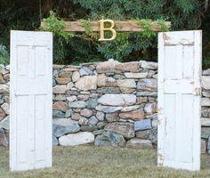 2 door arbor for a custom vintage wedding ceremony in a garden setting