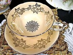 PARAGON TEA CUP AND SAUCER PEACH & PLATINUM PATTERN TEACUP WIDE MOUTH