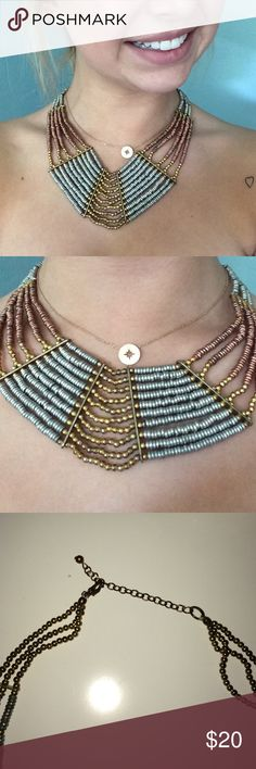 Free people statement necklace. Gorgeous Auburn silver and gold statement beaded necklace. No beats are missing and hook is in perfect condition. Free People Jewelry Necklaces