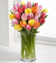 if you put a small pin hole just below the petals it will prevent the tulips from opening too big when they are in a vase