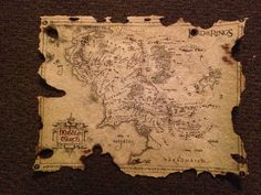 Lord of the Rings Middle Earth Map.   I burned all the edges to make it look battle damaged.