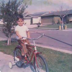 I loved this red bicycle, but especially the high-water, striped pants. #cycling #throwback #fashion