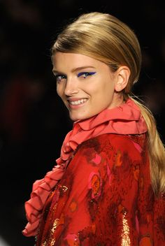 Crazy runway make up...but tone down a few notches and it IS wearable. Use a light touch of the blue and no dot on the bottom. Go heavy on the lashes and light on cheeks and lips. Voila' - Believe It Or Not.
