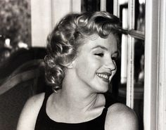 """Marilyn Monroe at the press conference for """"The Prince And The Showgirl"""" at the Savoy Hotel, 1956."""