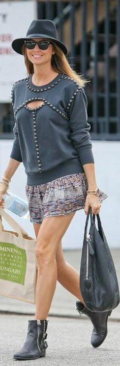 Stacy Keibler: Sweatshirt and skirt – Isabel Marant  Sunglasses – Ray Ban