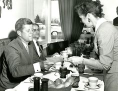 Senator John F. Kennedy, the Democratic nominee for President, meets with Democratic leaders at a luncheon in the Desert Caravan Inn following his downtown appearance and parade in Spokane, Washington (September 6, 1960).
