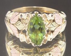 A beautiful Black HIlls Gold ring in gold in Rose, Green and Yellow Gold featuring a floral and grape design. Hallmarks: Black Hills Gold Condition: estate ring in very good condition. Queens Jewels, Black Hills Gold Jewelry, Peridot Jewelry, Gold Chains For Men, Black Rings, Gold Rings, Leaf Ring, Expensive Jewelry, Green Peridot
