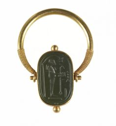 Finger Ring with a Representation of Ptah. Period: Late Period Place of origin: Egypt Medium: Green jasper, gold .thewalter - The Ancient Way of Life Dainty Jewelry, Antique Jewelry, Vintage Jewelry, Antique Rings, Jewelry Findings, Jewelry Art, Gold Jewellery, Ancient Egyptian Jewelry, Ancient Art