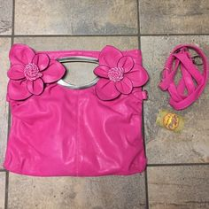 New with tags pink clutch purse Although this is new it has some worn marks on bottom. Not very noticeable. It is on back side. I don't know how this occurred. Bags Clutches & Wristlets