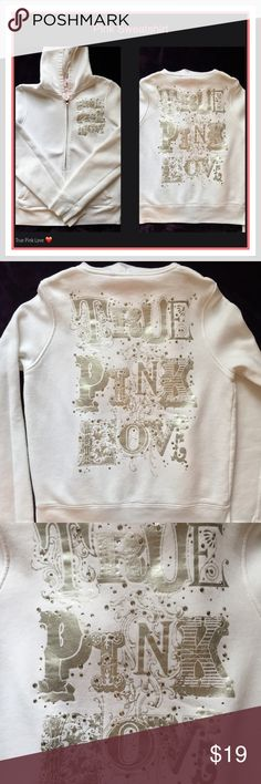 """Pink® Sweatshirt Beautiful old school Pink® sweatshirt in White that says """"True Pink Love"""" on the left side of Sweatshirt in Silver foil with pretty bling around it and the same design that covers the back. All sequins is intact. This is a very nice sweatshirt for its age. The only real signs of wear is three faint yellow stains as shown in the last picture. One on the right arm, one on the bottom by the zipper, and one on the front in the middle by the zipper. No trades. Use Offer Button…"""