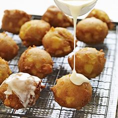 """Apple Fritters with calvados glaze-  2c AP flour 1/3c sugar 1T baking powder 1/2t salt 3/4t cinnamon 1/4t nutmeg 2 Granny Smith apples, peeled, cored & 1/4"""" dice 3/4c apple cider 2 eggs, lightly beaten 3T butter, melted 1t vanilla 6c vegetable oil 2c confectioners' sugar 2T apple cider 2T Calvados  -"""