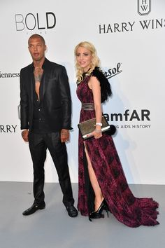 US model Jeremy Meeks (L) and guest arrive for the amfAR's 24th Cinema Against AIDS Gala on May 25, 2017 at the Hotel du Cap-Eden-Roc in Cap d'Antibes, France. / AFP PHOTO / ALBERTO PIZZOLI
