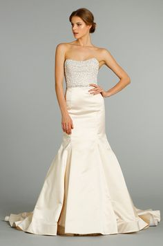 A sparkling strapless bodice tops off this trumpet silhouette Jim Hjelm wedding dress, Fall 2012.