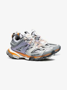 fdbf26f3132 Balenciaga   Grey Track Sneakers - These white, grey and orange sneakers  feature a high