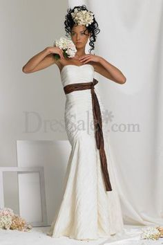 This bride is stunning in white with a chocolate brown sash. This dress is perfect for a fall wedding.