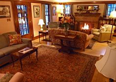 Period furnishings and Persian carpets complement the hardwood maple floors and Arts & Crafts woodwork. Garden Wall Inn Whitefish