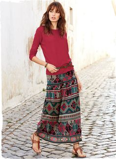 Peruvian Connection | Pattern bands from an Anatolian kilim emblazon our folkloric #Pima Cotton Sivas skirt. Jacquard knit in bright jewel tones, with a slim drop yoke that releases into a billowing skirt.