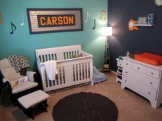 Using a blue and orange color palette along with music notes and guitars set the mood for this music themed nursery.