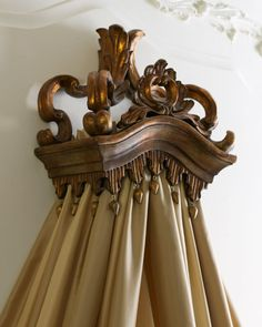 #Majestic #Bed #Crown - Horchow #furnishings #decor #interior #baroque #style #acanthus #tassels #handcrafted of resin to resemble wood with antiqued golden finish . removable metal bar for tab curtains or draping fabric . . .