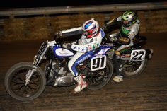 Mikey Martin battling with Rob Pearson on his Bonneville Performance Triumph flat track machine