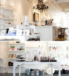 Beautiful retail space. Love the white shelving & table for display.