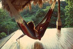 Palm trees, pools, swinging hammocks & drinks at this Nicarauga retreat. Dream group getaway destination.