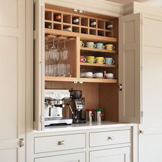 A cup of coffee on a brisk, blustery Thursday morning ⭐☕️ this breakfast / drinks cupboard has bi-fold doors so it can be left open when in use - the clients told us when we were photographing this space that it hadn't been closed once - they loved it open all the time. #humphreymunson |  @paullmcraig