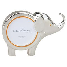 Silver-plated picture frame with an elephant silhouette.  Product: Picture frameConstruction Material: Metal