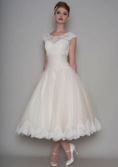 Illusion Cap Sleeve Classic Tea Length Ivory Lace and Tulle Wedding Dress Classic wedding dress accenting with cap sleeves subtle sheer lace overlay on the strapless sweetheart neckline bodice. Finished with twist waist and ball gown tea length skirt. Vintage Inspired Wedding Dresses, Western Wedding Dresses, Classic Wedding Dress, Wedding Dress Trends, Perfect Wedding Dress, Bridal Dresses, Bridesmaid Dresses, Dresses Uk, Reception Dresses