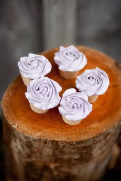 I prefer cake, but the flowers are neet, and it looks like they are sitting on wood- place the cakes on wood rounds on the table!