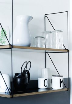 Mid-century style shelving. A Danish home is given a fresh, monochrome make-over. Tia Borgsmidt.