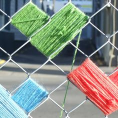I'm tempted to yarn bomb the ugly chain link fence around our yard.