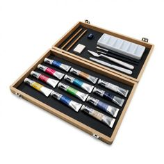 """Winsor & Newton Winton Oil Colors are made from moderately priced pigments, formulated for student and amateur artists. This Winton Oil Color Large Wooden Art Box stylish wooden box contain a selection of Winsor & Newton Winton Oil paints and painting accessories. Includes 12 Winsor & Newton Winton Oil Paints, 2 brushes, 2 pencils, 1 plastic palette, 2 palette knives, 1 eraser, 1 sharpener and 1 leaflet. Box dimensions measures 14-1/2"""" x 9"""" x 2"""". #GiftIdeas #ArtSupplies"""