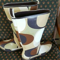 Coach paisley scarf print rainboots Coach paislet brown tan black green rainboots. Some lite scratchmarks that arent noticeable. Right boot on inside side has some scuff marks. See picture 3. Wont be seen when worn because of location. Coach Shoes Winter & Rain Boots