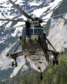 A Royal Navy Westland Seaking helicopter of the Commando Helicopter Force (CHF) is pictured on exercise in the mountains of southern Germany. Attack Helicopter, Military Helicopter, Military Aircraft, Royal Marines, Armada, Air Show, Aircraft Carrier, Royal Navy, War Machine