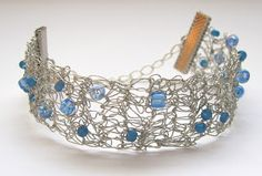 Crochet bracelet made from silver thread and beads.