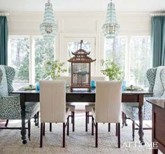 This just works.  Love the chairs.  Chandeliers ... not so much.  Too trendy for my taste