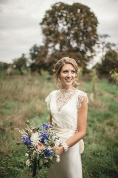 A Sweet September Wedding With A Touch of 1930's Glamour, Pom Poms, Peach, Gold and Blue - Love My Dress UK Wedding Blog
