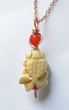 Koi fish pendant Carved bone carnelian hand carved.  $22.00