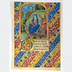 """Pergamentblatt aus einem prächtig verzierten mittelalterlichen Stundenbuch. Mit detailreicher und farbenfroher Miniaturmalerei des biblischen Motivs """"Flucht nach Ägypten"""", umgeben von Blüten- und Rankendekor, liebevoller Goldbemalung und einer großen Goldinitiale. Herausgegeben in Frankreich, Paris, um 1480."""