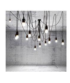 Suspension Maman. Architecturale, spectaculaire, tentaculaire, la suspension Maman tisse ses câbles le long des plafonds afin de former de vraies toiles lumineuses, compositions graphiques et contemporaines à moduler à l'envi. De la rosace centrale partent 14 câbles aux longueurs différentes (3 et 4 m) qui se fixent aux plafonds à l'aide de crochets. Resserrés du centre ou très éloignés, les câbles soutiennent des ampoules LED qui retombent en grappe, telles des gouttes de pluie…